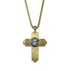 BEJEWELLED LATIN CROSS PENDANT 9ct Satin finish gold cross with Swiss blue topaz and diamond detail, on gold snake chain