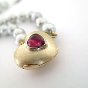 gold locket with pearls and pink tourmaline is an example of our bespoke design jewellery